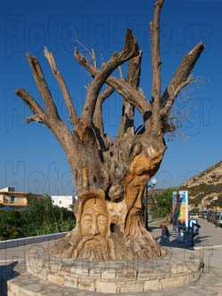 Matala in Heraklion. Traditional sculpture on the trees